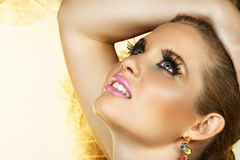 Golden eye make-up and pink lips Royalty Free Stock Photos