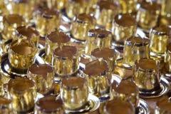 Eyelets, rivets loose close-up. Golden eyelets, rivets loose close-up Stock Photography