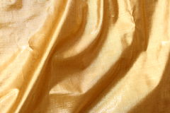 Golden fabric. A photo of golden fabric Stock Photo