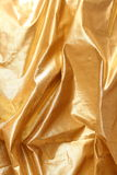 Golden fabric Stock Photography