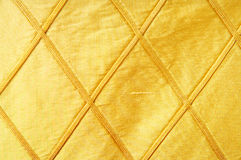 Golden fabric as background Stock Photos