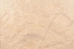 Golden fabric background. Background fabric golden brown, wrinkled Stock Photography