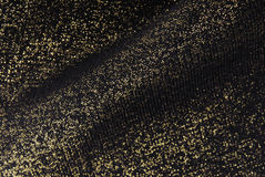 Golden fabric texture background Stock Images