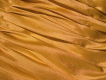 Golden fabric texture Royalty Free Stock Photography