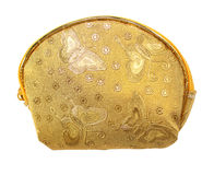 Golden fabric wallet for coins. Isolated on white background Stock Photo
