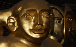 Golden face. Shot in The Barbican place, London Royalty Free Stock Images