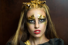 Golden face art. Golden woman Taurus, art. Christmas New Year. Photo with big free space, area place for text, inscription or buttons (if you use this photo for royalty free stock photos