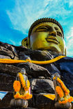 Golden Face of the Buddha under Blue Sky Stock Image