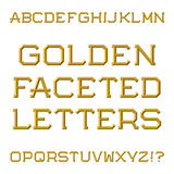 Golden faceted capital letters. Trendy and stylish font. Isolate Stock Photography