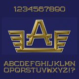 Golden faceted letters and numbers with winged initial monogram. Royalty Free Stock Photo