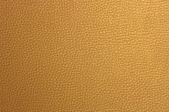 Golden fake leather surfaced Stock Photos
