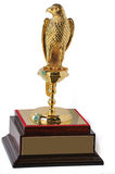 Golden Falcon Trophy. Golden color Trophy with UAE's national bird, falcon. Isolated on white royalty free stock image