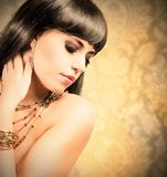 Golden fashion with beautiful woman Stock Photography