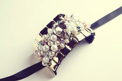 Golden fashion handmade bracelet on white Stock Photo