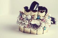 Golden fashion handmade bracelet on white Stock Image