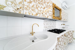 Golden faucet Stock Images