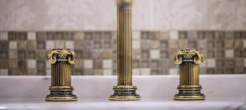 Golden faucet Stock Photography