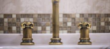 Golden faucet Stock Photography