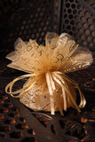 Golden Favour with ribbon Stock Images