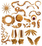 Golden feather elements. Golden feather forms elements and ornaments collection, with clipping paths, isolated on white royalty free stock images