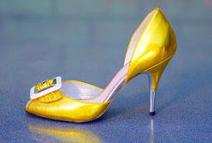 Golden female stiletto Royalty Free Stock Photos