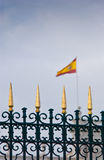 Golden fence and the flag of the Royal Palace in Madrid, Spain Stock Photo