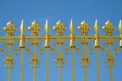 Golden fence with needles and ornaments Royalty Free Stock Images