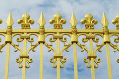Golden fence with ornaments Stock Photos