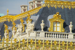 Golden fence with ornaments and roof of Versailles palace Royalty Free Stock Photography