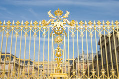 Golden fence and Versailles plalace. The Palace Versilles is a royal chateau in Versailles City paris, France. It was added to the UNESCO list of World Stock Images