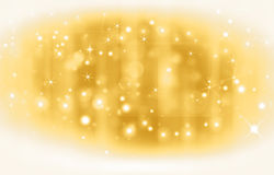 Golden festive background. Glittery golden festive background with stars Stock Photo