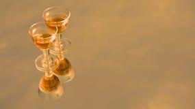 Golden festive glasses Stock Photos