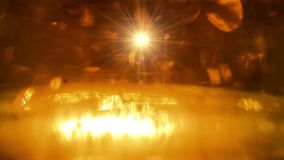 Golden festive lights. Star flies up from the glow stock video footage
