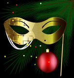 Golden festive mask. Festive background and a carnival half mask decorated with beads and ribbon Stock Photos