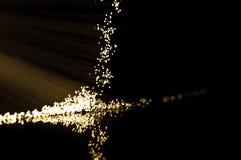 Golden fibre optic strands. Royalty Free Stock Image
