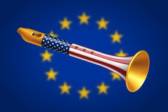 Golden fife with USA flag on blurred European Union flag. Background. Geopolitical interaction of USA and EU and foreign policy concept Stock Photo