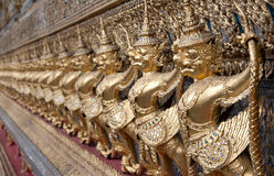 Golden figures warrior in royal palace Royalty Free Stock Photo
