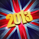 Golden figures year 2013 over shining UK flag Stock Photography