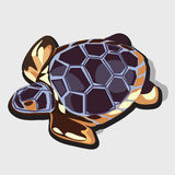 Golden figurine of turtle with blue shell Royalty Free Stock Images