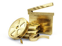 Golden Film Reels and Clapper board. 3d rendering Royalty Free Stock Photography