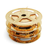 Golden film reels stack. 3d illustration of golden film reels stack  on white background Royalty Free Stock Photos