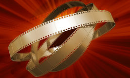 Golden films. On red background Stock Photography