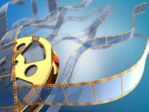 Golden filmstrips background. Golden film reel and many waves of filmstrips on blue background Royalty Free Stock Photos
