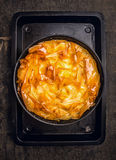 Golden Filo pastry pie  on black baking tray Stock Photography