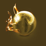 Golden Fire Ball. A shinny and fiery reflective golden soccer ball placed on a beautiful golden background Royalty Free Stock Photography
