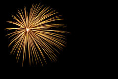 Golden firework on black background. Isolated golden firework on black background Royalty Free Stock Images