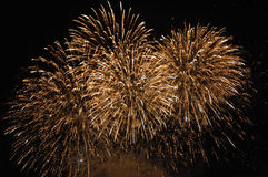 Golden fireworks. Several big golden fireworks explosions, slow shutter Royalty Free Stock Photography