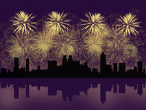 Golden fireworks above big city silhouette Stock Photo