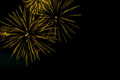 Golden fireworks border on the black sky background with copyspa Stock Images
