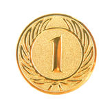 Golden first place medal isolated. On white background Stock Images